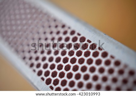 Box of safety matches with its black striking surface with the honeycomb shapes on the narrower side  - stock photo