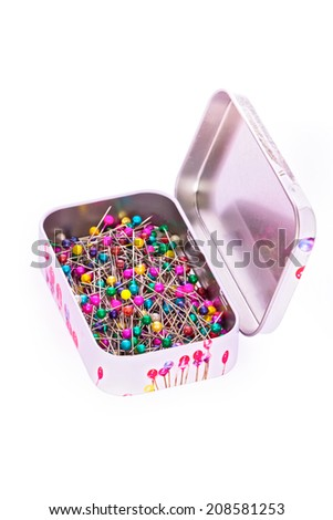 Box of sewing pins in metall box isolated with clipping path - stock photo