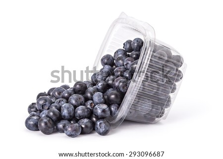 Box or punnet and spilled fresh ripe organic blueberries on a white background - stock photo