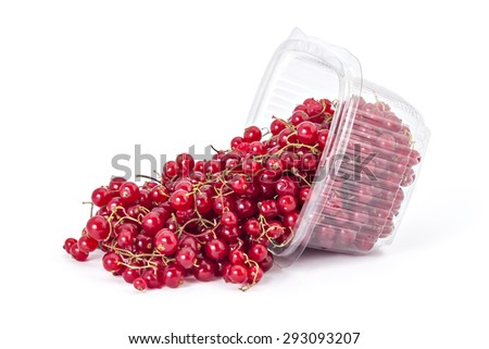 Box or punnet and spilled fresh ripe organic red currants on a white background - stock photo