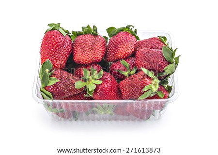 Box or punnet of fresh red ripe organic strawberries isolated on white background - stock photo
