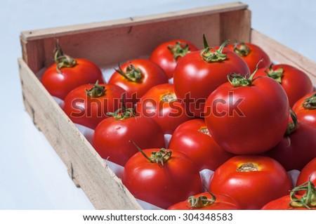 Box with fresh tomatoes - stock photo