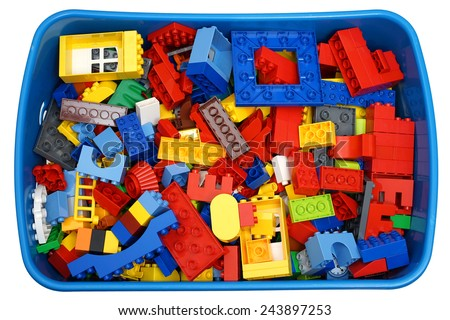 box with many cubes and toys - stock photo