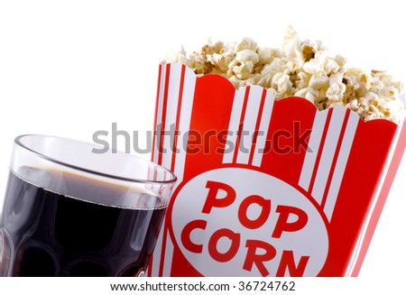 Box with popcorn and a glass of cola isolated on white. - stock photo