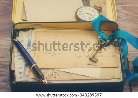 box with vintage mail and antique clock, retro toned - stock photo