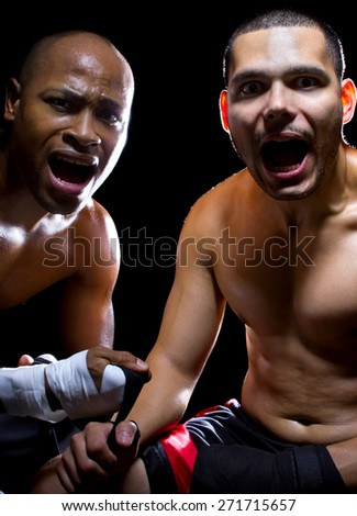Boxer and his coach looking shocked or in panic of failure.  They may be afraid of the competition or angry at a loss. - stock photo