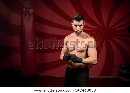boxer and streetfighter preparing for match, training and posing without gloves - stock photo