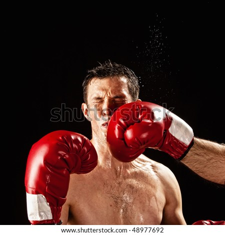 boxer being hit with sweat flying - stock photo