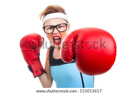 Boxer - fitness woman boxing wearing boxing gloves, focus on face - stock photo