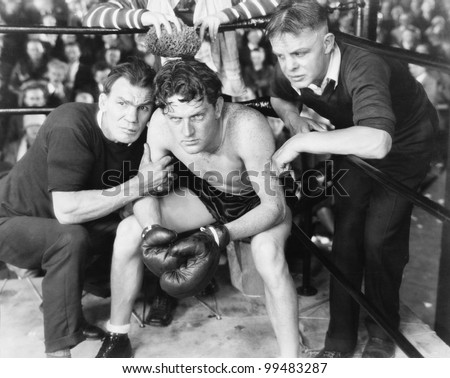 Boxer in corner with trainers - stock photo