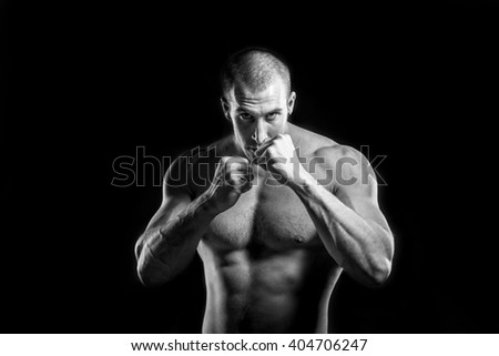 boxer man without boxing gloves isolated on black background - stock photo