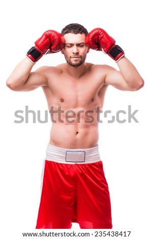 Boxer meditating before the fight - stock photo