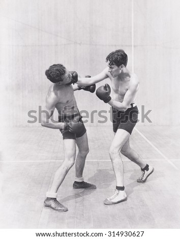 Boxer throwing a right hook - stock photo