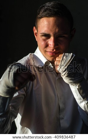 Boxer with a black background standing in a guard position and is waiting for a fight - stock photo