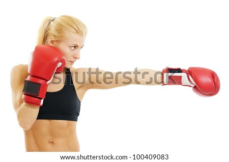 boxer woman during boxing exercise making direct hit with red gloves - stock photo