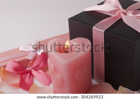 Boxes and candle - stock photo