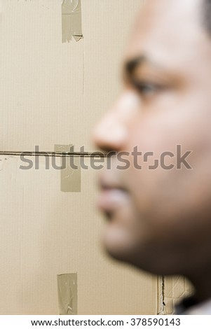 Boxes and face of a man - stock photo