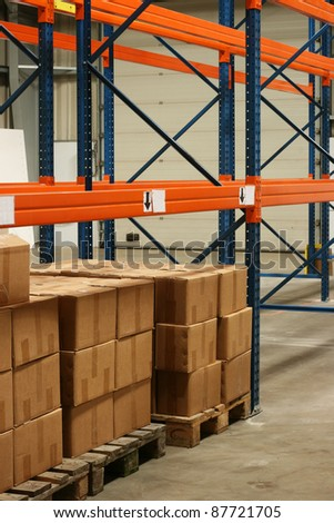 Boxes in a warehouse.  They are stored on some warehouse shelves. - stock photo