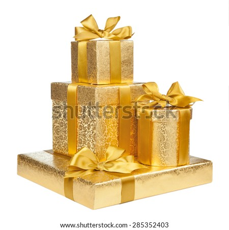 Boxes of gold wrapping paper isolated on white background - stock photo
