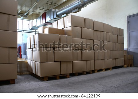 Boxes of goods in warehouse - stock photo