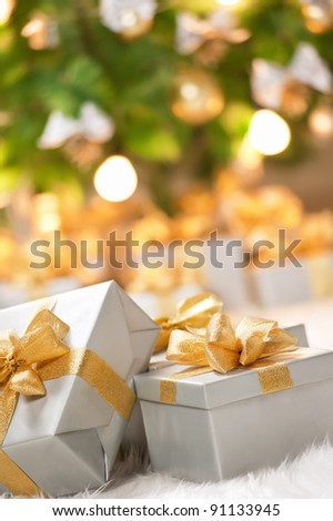 Boxes of presents under the Christmas tree - stock photo