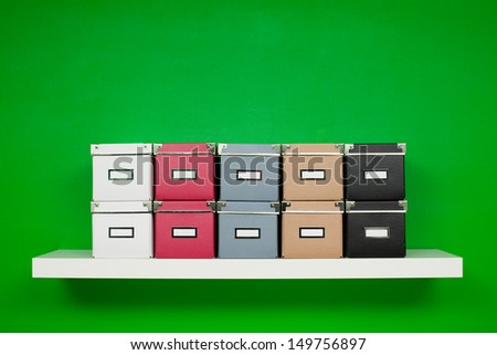 boxes on the shelf - stock photo