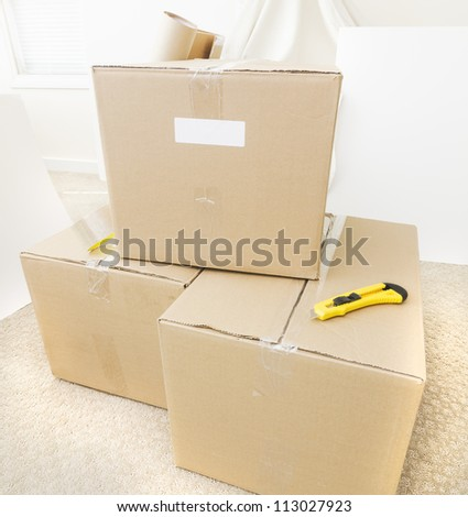 Boxes waiting to be unpacked - stock photo