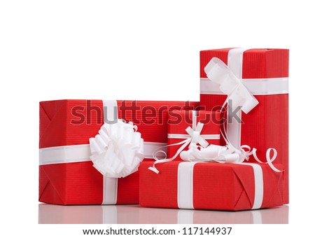 Boxes with Christmas presents wrapped in red paper, isolated on white - stock photo