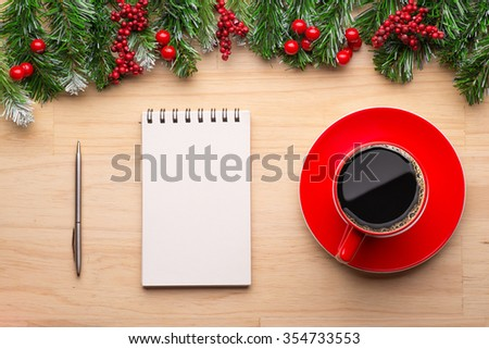 Boxes with gifts on a wooden background. White notepad. Happy new year. Space for text. Colorful Concept. New Year background. Christmas. Xmas. Noel. - stock photo