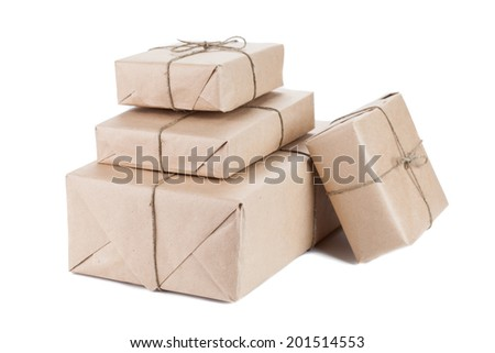 Boxes wrapped with brown kraft paper isolated on white background - stock photo