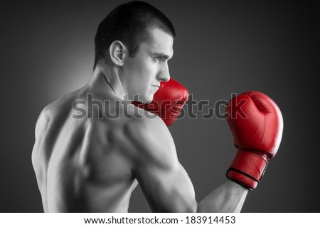 Boxing. Black and white fighter with red gloves. - stock photo