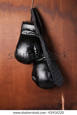 Boxing-glove hanging with a necktie - stock photo