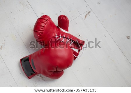 boxing glove on the gym floor - stock photo