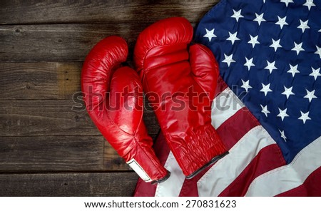 Boxing gloves and American flag with room for your type. - stock photo