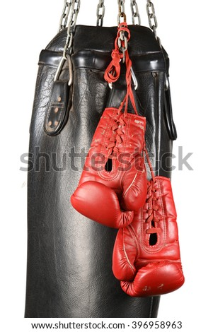 Boxing gloves and punching bag isolated - stock photo