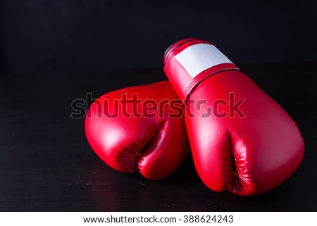 Boxing gloves for boxer with black background - stock photo