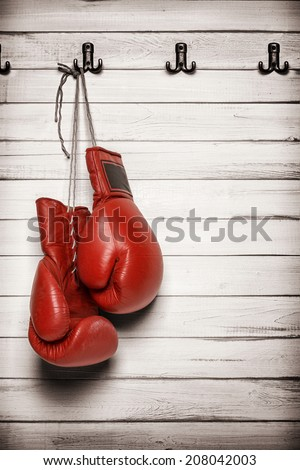 Boxing gloves hanging on wooden wall -including clipping path - stock photo