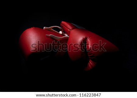 boxing gloves isolated in black - stock photo