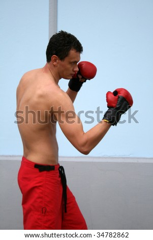 Boxing man - stock photo