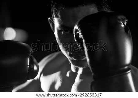 Boxing man ready to fight. black and white - stock photo