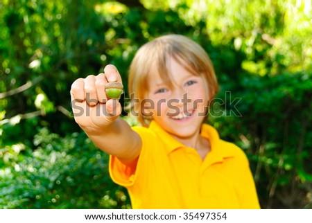 Boy and acorn - stock photo