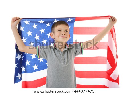 Boy and big American flag, on white background - stock photo