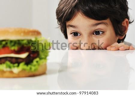 Boy and burger - stock photo