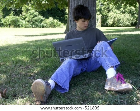 boy and computer reading as well - stock photo