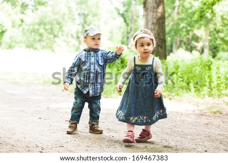 Boy and girl are playing in the park - stock photo