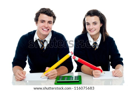 Boy and girl are ready to take up the general knowledge quest - stock photo