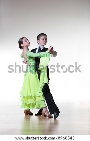Boy and girl dancing ballroom dance - stock photo