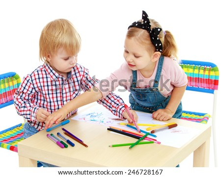 Boy and girl drawing with pencils sitting at the table.Isolated on white background - stock photo