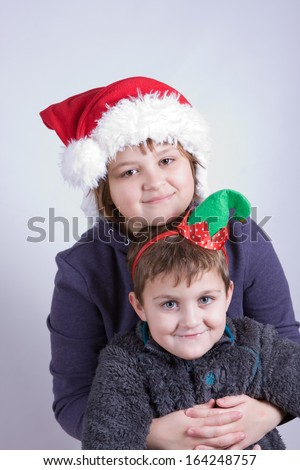 boy and girl happy at Christmas time - stock photo