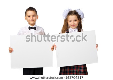 boy and girl holding a poster, studio, white background - stock photo